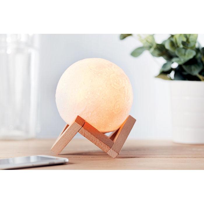 cassa bluetooth a forma di luna su supporto in legno di design